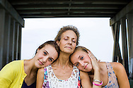 July 17, 2012; Virginia Beach, VA, USA; Julie Perry poses with her daughters Brook and Katie. Julie was diagnosed with cancer and passed away on February 14, 2012. Mandatory Credit: Peter J. Casey