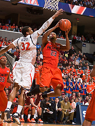 Virginia forward Mike Scott (32) defends Virginia Tech guard Malcolm Delaney (23).  The Virginia Cavaliers defeated the Virginia Tech Hokies 75-61 at the John Paul Jones Arena on the Grounds of the University of Virginia in Charlottesville, VA on February 18, 2009.