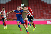 Richard Stearman of Sheffield United heads the ball away during the EFL Cup match between Sheffield United and Sunderland at Bramall Lane, Sheffield, England on 25 September 2019.