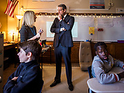 """08 APRIL 2019 - DES MOINES, IOWA: Rep. TIM RYAN talks to a 7th teacher during a classroom visit at Callanan Middle School. Ryan, a candidate for the Democratic ticket of the US presidency, visited Callanan Middle School in Des Moines to discuss education issues. Ryan declared his candidacy on the US television show """"The View"""" on April 4. Ryan, 45 years old, represents Ohio's 13th District, which includes Lordstown, where a large General Motors plant recently closed. He is the latest Democrat to announce his candidacy to be the Democratic nominee in the 2020 election. Iowa holds its presidential caucuses on Feb. 3, 2020.       PHOTO BY JACK KURTZ"""