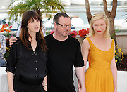 18.MAY.2011. CANNES<br /> <br /> ACTRESSES KIRSTEN DUNST AND CHARLOTTE GAINSBOURG WITH DIRECTOR LARS VON TRIER AT PHOTOCALL OF 'MELANCHOLIA' AT 64TH CANNES FILM FESTIVAL<br /> <br /> BYLINE: EDBIMAGEARCHIVE.COM<br /> <br /> *THIS IMAGE IS STRICTLY FOR UK NEWSPAPERS AND MAGAZINES ONLY*<br /> *FOR WORLD WIDE SALES AND WEB USE PLEASE CONTACT EDBIMAGEARCHIVE - 0208 954 5968*