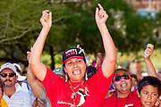 Apr. 19, 2009 -- PHOENIX, AZ: Women cheer during a United Farm Workers rally in central Phoenix Sunday. About 2,000 people marched from the Arizona State Capitol to Cesar Chavez Plaza in downtown Phoenix. The march was organized by the United Farm Workers of America to promote immigration reform.  Photo by Jack Kurtz