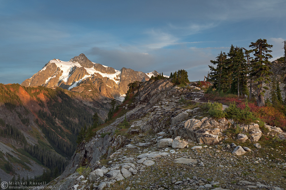 Sunset on Mount Shuksan from the Artist Point to Huntoon Point trail along Kulshan Ridge in Washington State's North Cascades Range. Photographed from Kulshan Ridge in the Mount Baker Wilderness. Mount Shuksan itself lies in North Cascades National Park.