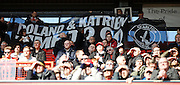 Fans pass a banner during the Sky Bet Championship match between Charlton Athletic and Middlesbrough at The Valley, London, England on 13 March 2016. Photo by Andy Walter.