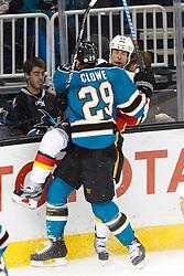 Feb 8, 2012; San Jose, CA, USA; San Jose Sharks left wing Ryane Clowe (29) checks Calgary Flames defenseman Chris Butler (44) during the first period at HP Pavilion. Calgary defeated San Jose 4-3. Mandatory Credit: Jason O. Watson-US PRESSWIRE