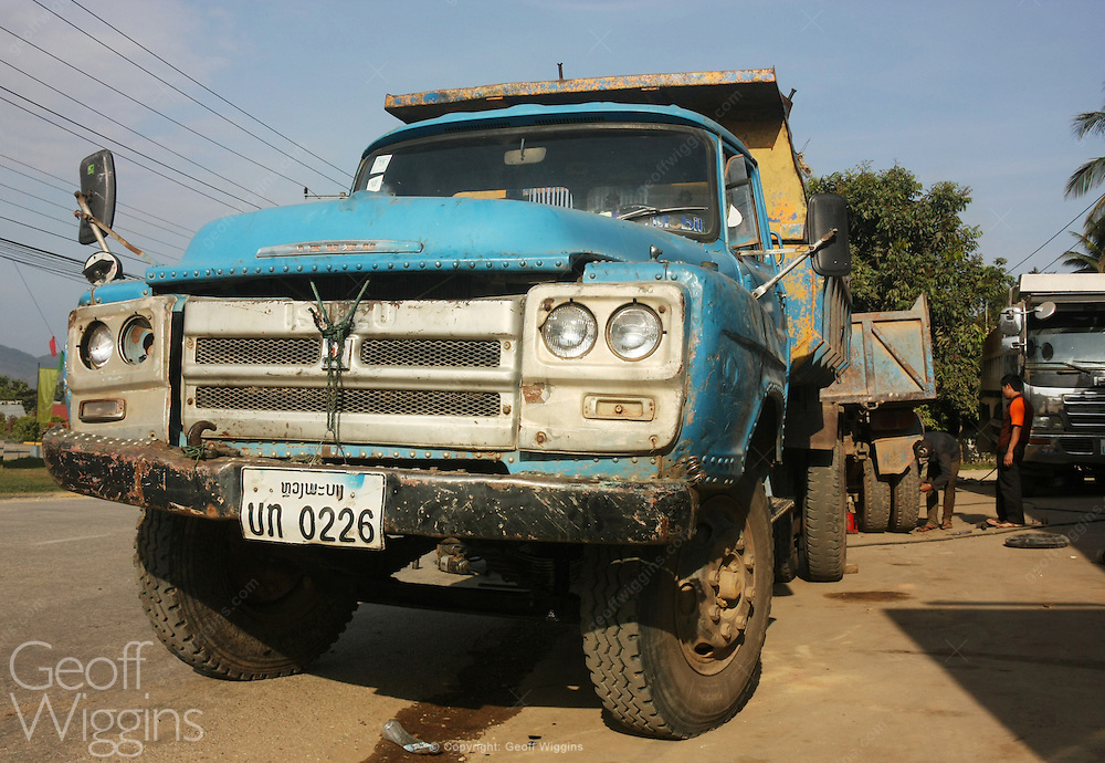 Vintage Isuzu dump truck under repair in northern Laos