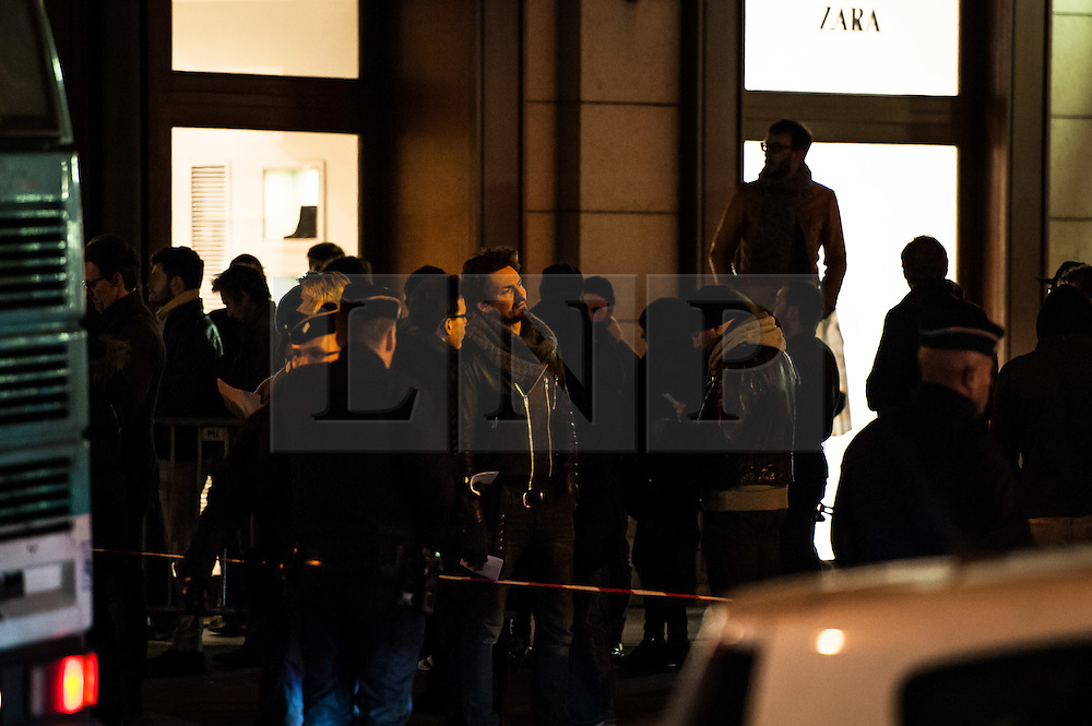 """© London News Pictures. 16/02/2015 Olympia Theatre, Paris: Fans queue before the Eagles of Death Metal """"resume their gig"""" three months after the terrorist attack at Bataclan that claimed the lives of 90 people on 13 November 2015. Heavy security was in evidence and media kept at a distance """"to preserve the dignity of returning survivors"""" according to a police spokesperson. Ticket holders of the fateful Bataclan concert were offered complimentary tickets for tonight's gig. Photo credit: Guilhem Baker/LNP"""