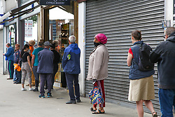 © Licensed to London News Pictures. 22/05/2020. London, UK. Members of the public queue outside Nationwide Building Society in Wood Green, north London and socially distance as lockdown restrictions eased. Photo credit: Dinendra Haria/LNP