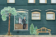 The original Bank of Camden building decorated with a mural in the Historic District of St Marys, Georgia.