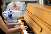 Piano being played in the ward at Chelsea and Westminster Hospital, London.