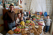 (MODEL RELEASED IMAGE).In the kitchen of their apartment in Palermo, Sicily, Italy, the Manzo family: Giuseppe, Piera Marretta, and their sons (left to right) Mauritio, Pietro, and Domenico, with their week's worth of food. The Manzo family is one of the thirty families featured in the book Hungry Planet: What the World Eats (p. 174)