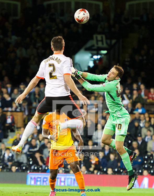 Goalkeeper Marcus Bettinelli of Fulham punches the ball clear during the Sky Bet Championship match at Craven Cottage, London<br /> Picture by Alan Stanford/Focus Images Ltd +44 7915 056117<br /> 24/10/2014