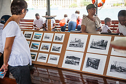Tour participants view the Coaling Exhibit with images of coal workers and the coaling industry.  9th Annual Dollar Fo' Dollar Culture and History Tour, a remembrance of the 1892 Coal Workers Strike on St. Thomas.  20 September 2014.  St. Thomas, USVI.  © Aisha-Zakiya Boyd