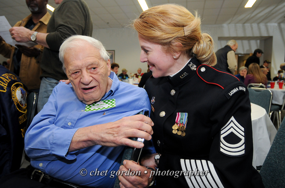 "U.S. Army Band vocalist MSGT. MaryKay Messenger (right) with a WWII veteran Herbert Geller (left) of Somers, NY at the Hudson Valley Honor Flight ""Meet and Greet"" at the Walden Firehouse in Walden, NY on Sunday, April 6, 2014. One Hundred WWII Veterans and their escorts will be onboard the Hudson Valley Honor Flight's fourth flight from Stewart International Airport to Washington, DC on April 26th.  © Chet Gordon for HVHF"