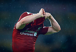 WOLVERHAMPTON, ENGLAND - Friday, December 21, 2018: Liverpool's James Milner pulls off his shirt as he celebrates after beating Wolverhampton Wanderers 2-0 during the FA Premier League match between Wolverhampton Wanderers FC and Liverpool FC at Molineux Stadium. (Pic by David Rawcliffe/Propaganda)