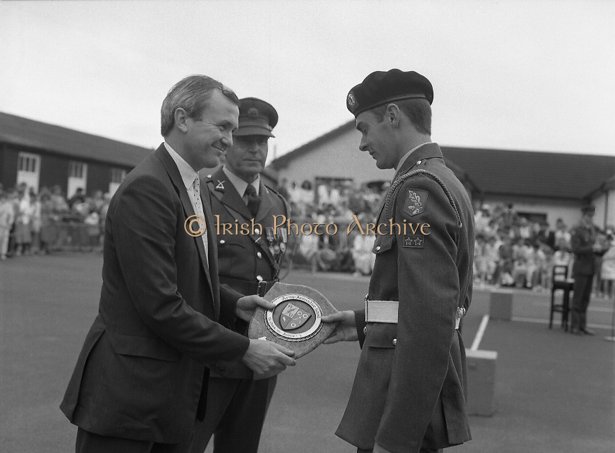 Army Apprentice Graduation Ceremony..1986..03.07.1986..07.03.1986..3rd July 1986..54 army apprentices graduated as tradesmen after completing three years of both military and technical training at the Army Apprentice School, Naas. The school is part of Devoy Military Barracks. The following trades are catered for: Radio Mechanic,Carpenter,Fitter, Electrician and Armourer..The newly graduated tradesmen will complete their basic military training at St Stephen's Barracks ,Kilkenny, for a further eight weeks..Mr John Witherington,Managing Director,Irish Shell, presented the awards...Picture shows Mr John Witherington,Managing Director,Irish Shell,presenting  the apprentices with awards in the various disciplines of Radio Mechanic,Carpenter,Fitter, Electrician and Armourer.