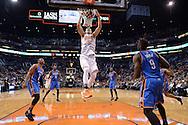 Feb 8, 2016; Phoenix, AZ, USA; Phoenix Suns center Alex Len (21) dunks the ball against the Oklahoma City Thunder at Talking Stick Resort Arena.  The Oklahoma City Thunder won 122- 106.  Mandatory Credit: Jennifer Stewart-USA TODAY Sports