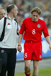 OSLO, NORWAY - Thursday, May 27, 2004:  Wales' Craig Bellamy limps off injured against Norway during the International Friendly match at the Ullevaal Stadium, Oslo, Norway. (Photo by David Rawcliffe/Propaganda)