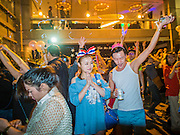 31 DECEMBER 2013 - BANGKOK, THAILAND:  Thais and tourists count down the final minutes of 2013 at the New Year's Eve Party in Ratchaprasong Intersection in Bangkok. Hundreds of thousands of people pack into the Ratchaprasong Intersection in Bangkok for the city's annual New Year's Eve countdown. Many Thais go the Erawan Shrine and Wat Pathum Wanaram near the intersection to pray and make merit.    PHOTO BY JACK KURTZ