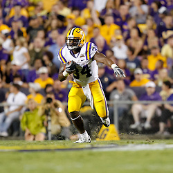 Sep 25, 2010; Baton Rouge, LA, USA; LSU Tigers running back Stevan Ridley (34) runs against the West Virginia Mountaineers during the first half at Tiger Stadium.  Mandatory Credit: Derick E. Hingle