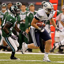 Sep 12, 2009; New Orleans, LA, USA; BYU Cougars running back Bryan Kariya (33) runs as Tulane Green Wave defensive back Shakiel Smith (49) pursues during the first half at the Louisiana Superdome.  BYU defeated Tulane 54-3. Mandatory Credit: Derick E. Hingle-US PRESSWIRE