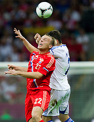 Denis Glushakov of Russia vs Giannis Maniatis  of Greece during the UEFA EURO 2012 group A match between  Greece and Russia at The National Stadium on June 16, 2012 in Warsaw, Poland.  (Photo by Vid Ponikvar / Sportida.com)