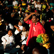 A Ghana supporter in Accra at an outdoor broadcast of the 2010 FIFA World Cup match between Ghana and Germany shows his dismay moments after Germany scored the only goal of the match.