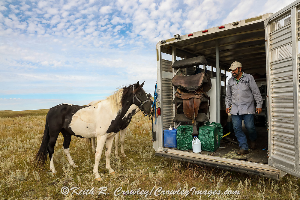 John Zeman steps from his horse trailer during a Montana prairie grouse hunt.