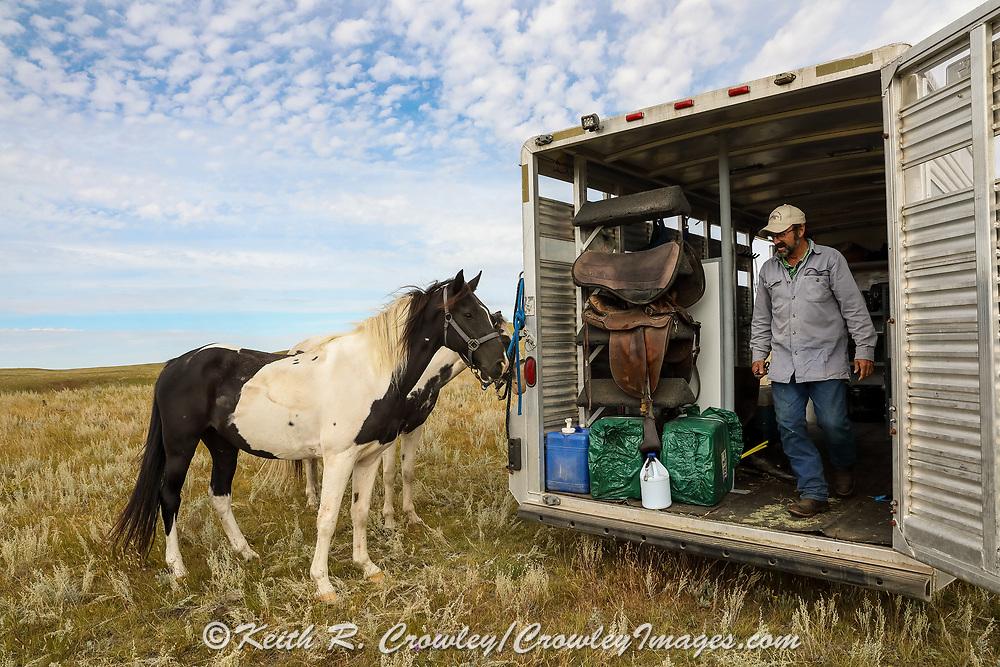 John Zeman steps from his horse trailer during a Montana prairie grouse hunt.