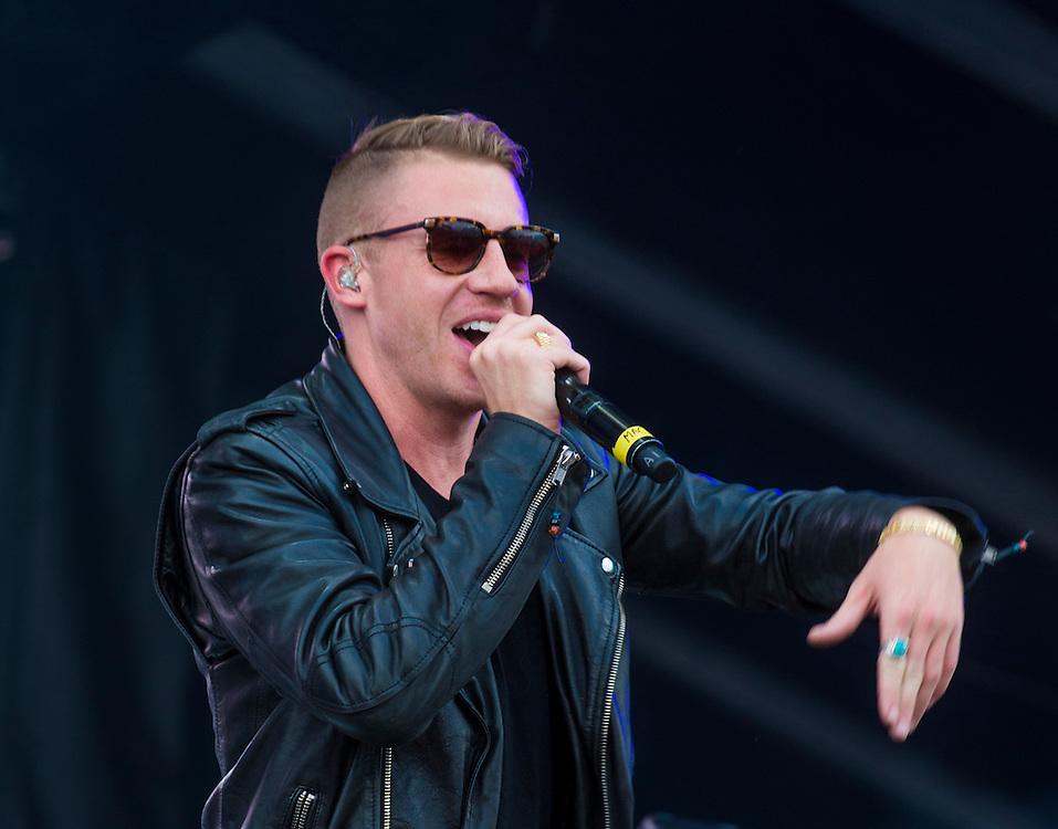 LAS VEGAS - SEP 20: Rapper Macklemore performs on stage at the 2014 iHeartRadio Music Festival Village on September 20, 2014 in Las Vegas.