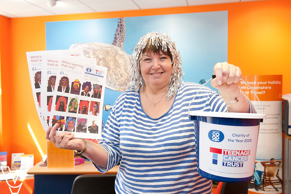 Pictured is Long Sutton travel centre colleague Sally New<br /> <br /> Lincolnshire Co-operative colleagues have been raising money for the Teenage Cancer Trust during their 'Get Wiggy With It' day!<br /> <br /> Date: July 31, 2015