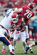 FAYETTEVILLE, AR - OCTOBER 31:  Alex Collins #3 runs behind the block of Dan Skipper #70 of the Arkansas Razorbacks during a game against the UT Martin Skyhawks at Razorback Stadium on October 31, 2015 in Fayetteville, Arkansas.  The Razorbacks defeated the Skyhawks 63-28.  (Photo by Wesley Hitt/Getty Images) *** Local Caption *** Alex Collins; Dan Skipper