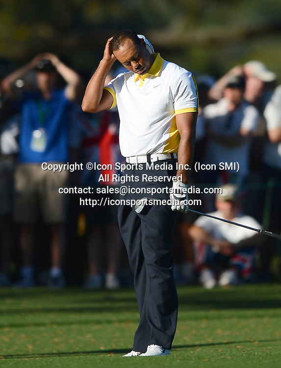 April 12, 2013 - Augusta, GA, USA - Tiger Woods rubs his head after hitting into the water on the 15th hole during second-round action of the Masters at Augusta National Golf Club, Friday, April 12, 2013, in Augusta, Georgia.