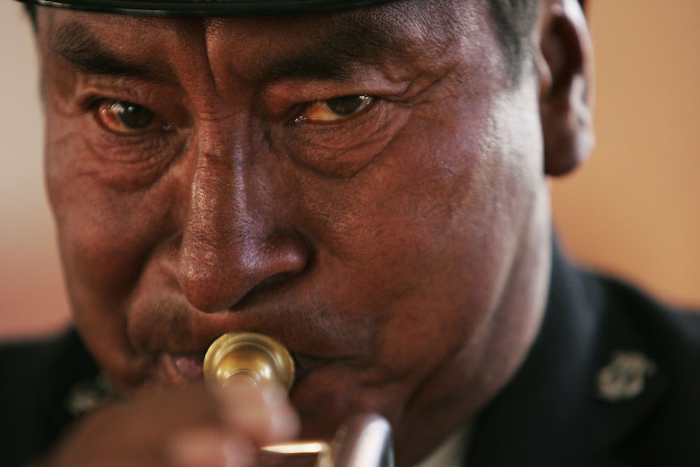 A man plays the trumpet in El Alto, Bolivia.