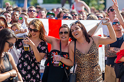 Fans enjoy the sun as they watch the game on the outdoor big screen - Ryan Hiscott/JMP - 07/07/2018 - FOOTBALL - Ashton Gate - Bristol, England - Sweden v England, World Cup Quarter Final, World Cup Village at Ashton Gate