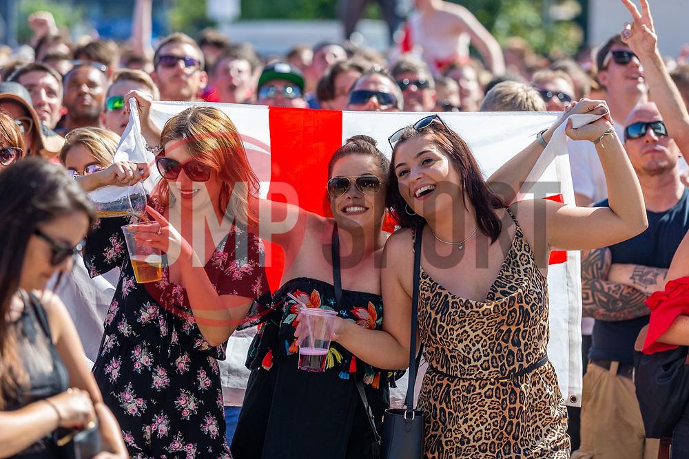 Fans enjoy the sun as they watch the game on the outdoor big screen - Ryan Hiscott/JMP - 07/07/2018 - FOOTBALL - Ashton Gate - Bristol, England - Sweden v England, World Cup Quarter Final, World Cup Village at Ashton Gate