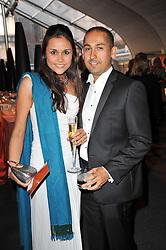 NICOLA HARFITT and HOOTAN AHMADI at a gala evening in aid of Ubuntu Education Fund held at Battersea Power Station, London on 4th May 2011.