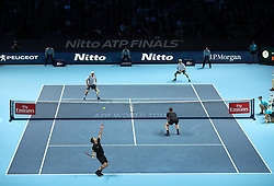 Bruno Soares (bottom left) and Jamie Murray in action during their doubles match against Mike and Bob Bryanduring day two of the NITTO ATP World Tour Finals at the O2 Arena, London.