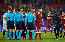 SEVILLE, SPAIN - Tuesday, November 21, 2017: Liverpool's captain Jordan Henderson speaks with the referee Felix Byrch after the 3-3 draw during the UEFA Champions League Group E match between Sevilla FC and Liverpool FC at the Estadio Ramón Sánchez Pizjuán. (Pic by David Rawcliffe/Propaganda)