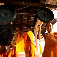 Monks ring gongs, Luang Phrabang, Laos