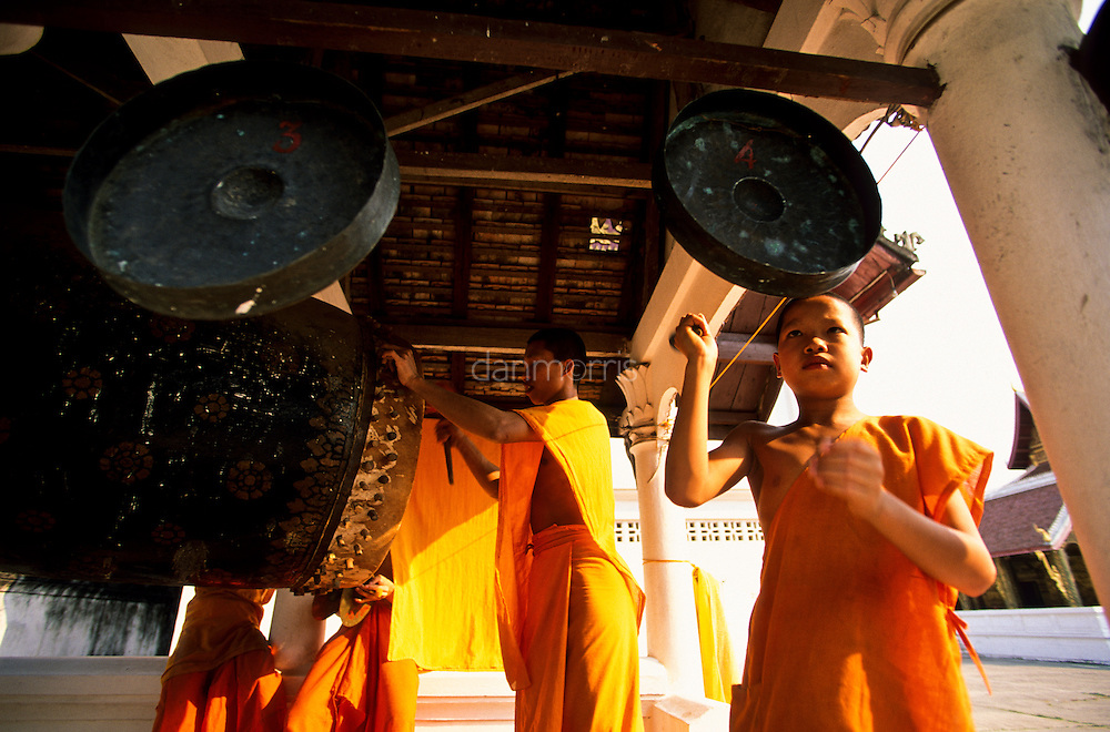 Monks ring gongs, Luang Phrabang, Laos