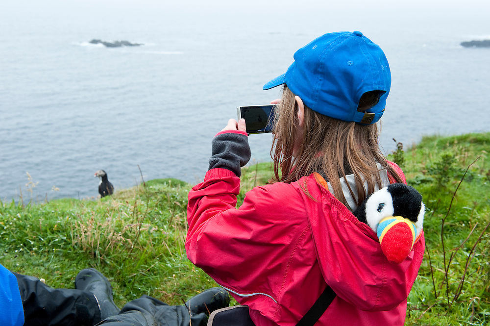 Iona photographing puffins, Lunga, Scotland