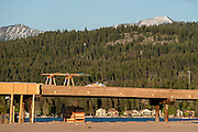 An eastward looking close-up view across the north shore beach with the bridge disrupting the scenic beauty of the Swan Range.   Destruction of the lakebed and the resulting loss of scenic value to the area caused by construction of a private bridge to Dockstader Island on the north shore of Flathead Lake in Bigfork, Montana, in violation of the state's Lakeshore Protection Act, as photographed on May 20, 2015.