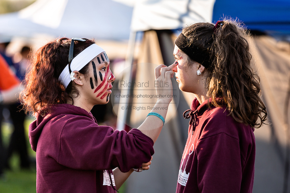 Players apply face paint as they get ready for the 7th Annual Quidditch World Cup April 5, 2014 in Myrtle Beach, South Carolina. The sport, created from the Harry Potter novels is a co-ed contact sport with elements from rugby, basketball, and dodgeball. A quidditch team is made up of seven athletes who play with broomsticks between their legs at all times.