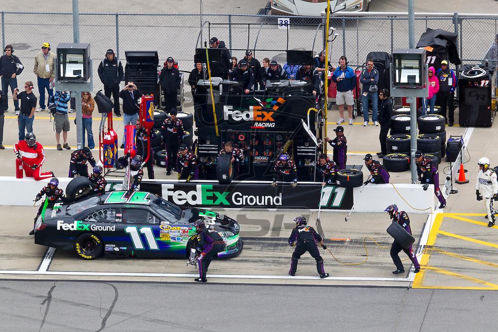 KANSAS CITY, KS - APR 22, 2012:  Denny Hamlin (11) races during the STP 400 at the Kansas Speedway in Kansas City, KS.