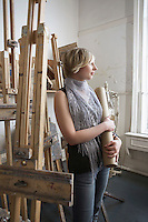 Female art student looking out of the window in studio