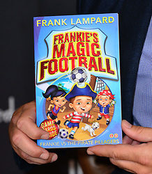 Frank Lampard booksigning at Harrods Toy Kingdom.  Chelsea midfielder signs copies of his debut children's book, Frankie's Magic Football: Frankie vs The Pirate Pillagers. The book is the first of five, released throughout the year. London, United Kingdom,<br /> Saturday, 22nd June 2013<br /> Picture by Nils Jorgensen / i-Images