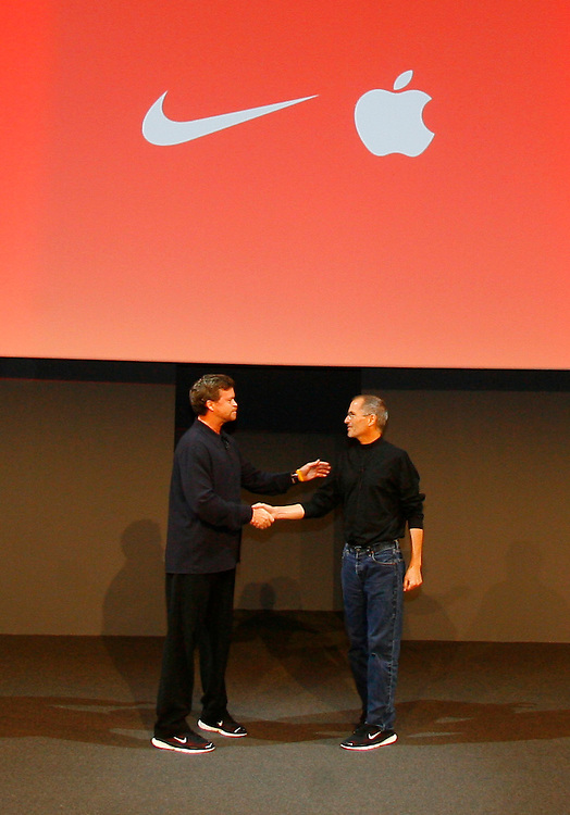 Nike CEO Mark Parker and Apple CEO Steve Jobs introduce the Air Zoom Moire at a press conference in New York City Tuesday May 23, 2006. The Air Zoom Moire is the first footwear designed to communicate with Apple's iPod..