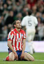 MADRID, SPAIN - Sunday, March 28, 2010: Club Atletico de Madrid's Alvaro Dominguez looks dejected as Real Madrid Club de Futbol score a goal during the La Liga Primera Division Madrid Derby match at the Estadio Santiago Bernabeu. (Pic by Hoch Zwei/Sprimont Press/Propaganda)