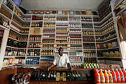 Godfrey K working at the off licence of Andrew and brothers Shopping Centre. Fort Portal. Uganda. Africa.